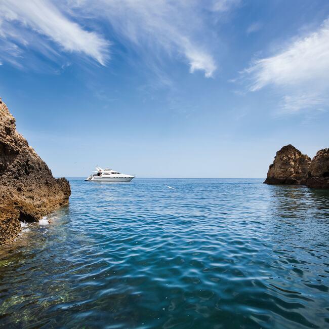 Yacht on Algarve coastline