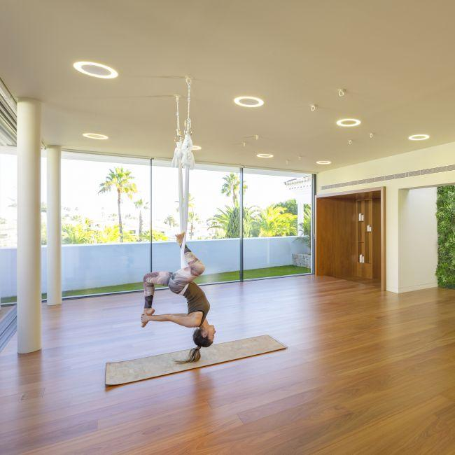 Aerial yoga lessons available at Hypoxy & Yoga Studio.