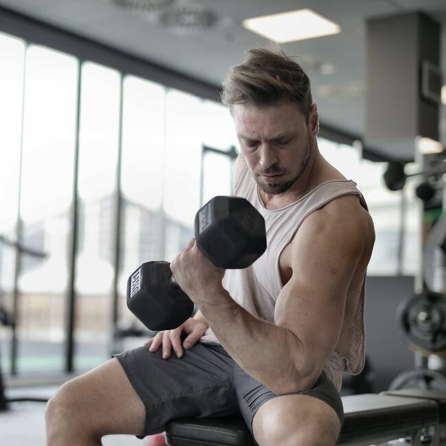 Health Club & Gym: Man exercising.