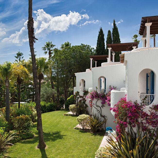 Oasis Suites exterior garden view.