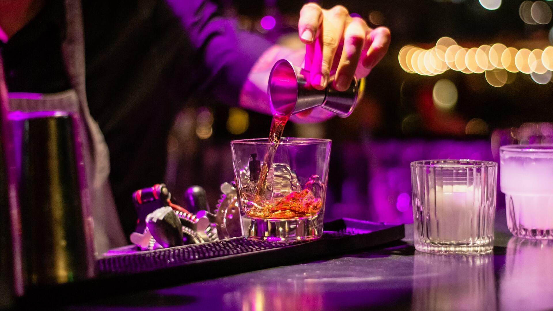 Bartender serving drinks at V-club