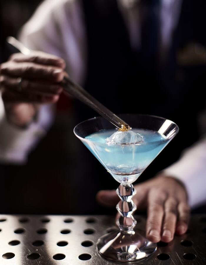 Oasis Bar Bartender preparing cocktail