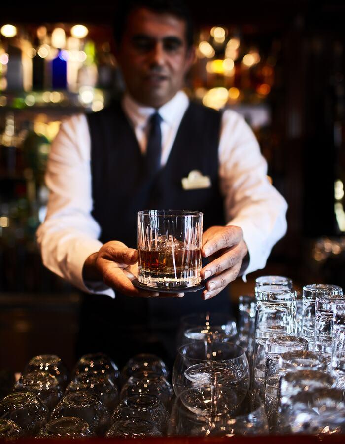 Oasis Bar Bartender handling drink
