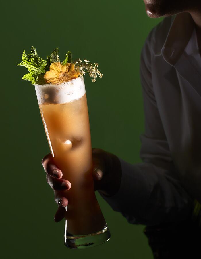 Bartender holding generic cocktail