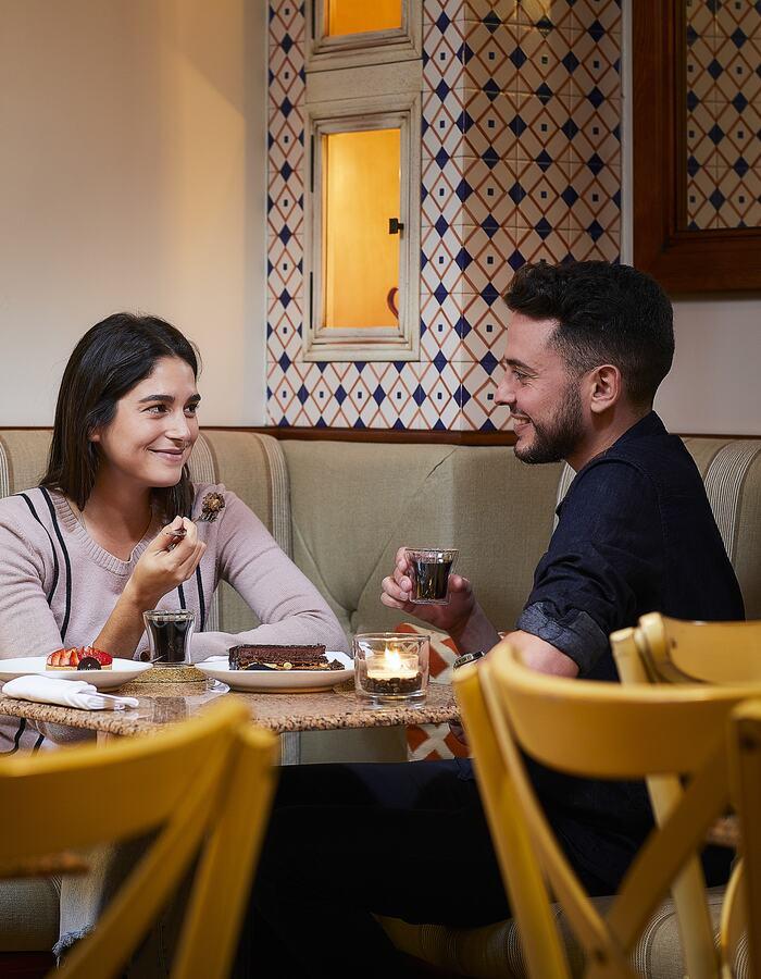 Couple having dinner at Adega Restaurant.