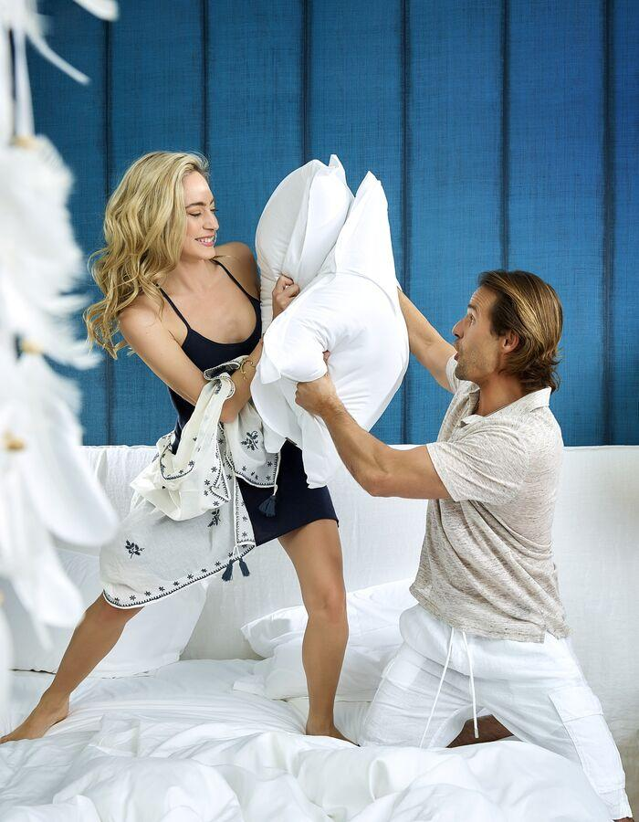 Vila Vita Collection: Couple having pillow fight.