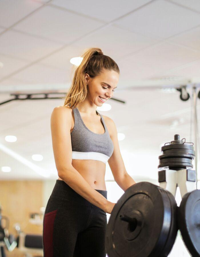 Health Club & Gym: Woman exercising.